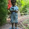 Boy holding Bird on step Solid Bronze Sculpture (1) | Avant Garden