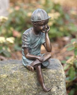 Fine Cast Bronze Sculpture Boy Sitting Wearing Cap