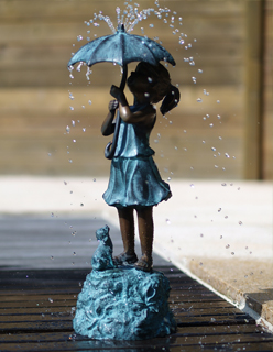 Bronze girl with umbrella sculpture, Christmas gift