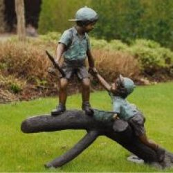 Fine cast Bronze Sculptures Boys playing on Tree trunk